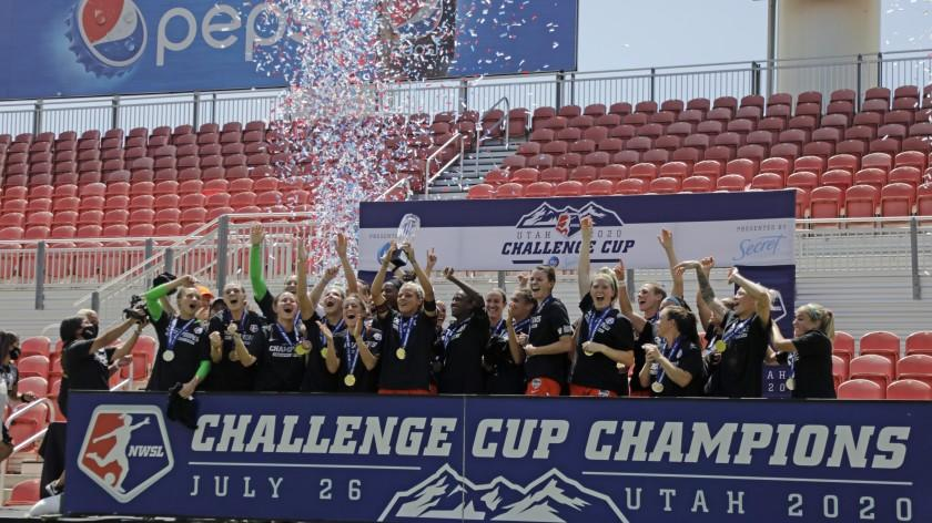 Houston Dash's Rachel Daly hoists the trophy with teammates after defeating the Chicago Red Stars to win the championship soccer game of the NWSL Challenge Cup Sunday, July 26, 2020, in Sandy, Utah. (AP Photo/Rick Bowmer)