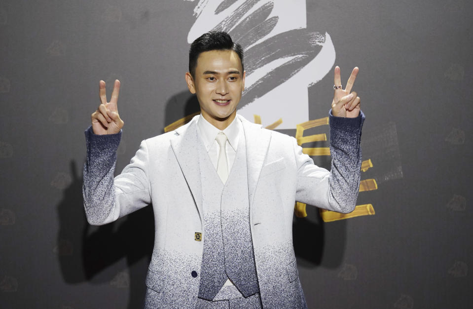 "Taiwanese actor Liu Kuan-ting arrives at the 57th Golden Horse Awards in Taipei, Taiwan, Saturday, Nov. 21, 2020. Liu is nominated for Best Leadting Actor for the film ""My Missing Valentine"" at this year's Golden Horse Awards. (AP Photo/ Billy Dai)"