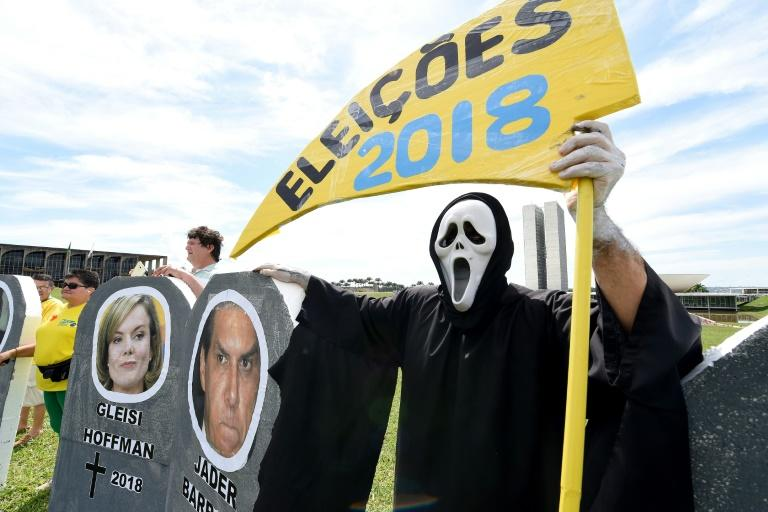 Protester attend a rally against corruption in Brasilia on March 26, 2017
