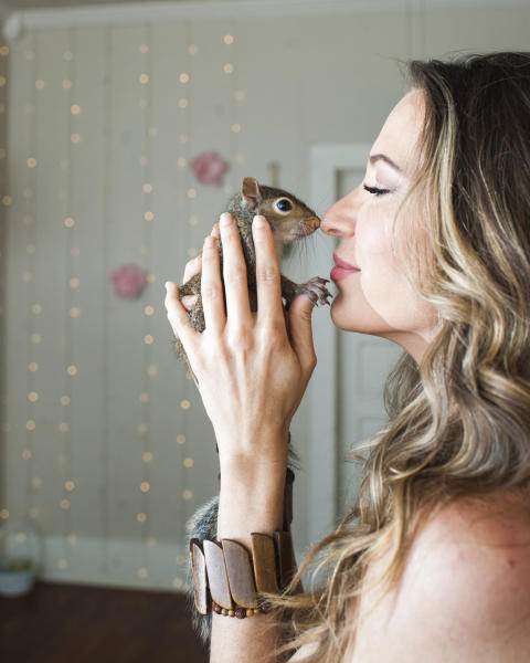 In a photo provided by Joey Morvant, Emily Istre, of Lafayette, La., holds a squirrel she named Willamina on April 21, 2020. She took care of the squirrel, which she also called One Eyed Willa, for several weeks after her mother found it alone in a backyard. The Louisiana Department of Wildlife & Fisheries took the squirrel from Istre on Thursday, April 23, 2020, and sent it to a wildlife rehab specialist. (Joey Morvant via AP)