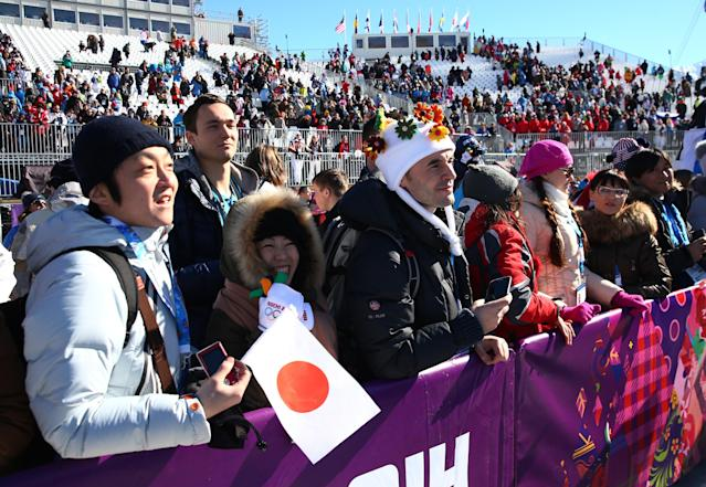 SOCHI, RUSSIA - FEBRUARY 08: Fans look on during the Snowboard Men's Slopestyle Final during day 1 of the Sochi 2014 Winter Olympics at Rosa Khutor Extreme Park on February 8, 2014 in Sochi, Russia. (Photo by Cameron Spencer/Getty Images)
