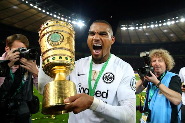 Soccer Football - DFB Cup Final - Bayern Munich vs Eintracht Frankfurt - Olympiastadion, Berlin, Germany - May 19, 2018 Eintracht Frankfurt's Kevin-Prince Boateng celebrates with the trophy after winning the DFB Cup REUTERS/Michael Dalder DFB RULES PROHIBIT USE IN MMS SERVICES VIA HANDHELD DEVICES UNTIL TWO HOURS AFTER A MATCH AND ANY USAGE ON INTERNET OR ONLINE MEDIA SIMULATING VIDEO FOOTAGE DURING THE MATCH. TPX IMAGES OF THE DAY