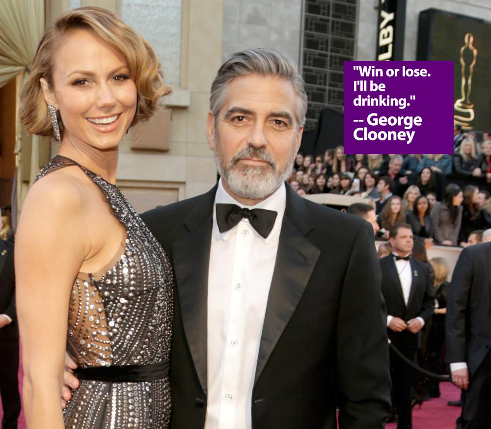 Actress Stacy Keibler (L) and actor George Clooney arrive at the Oscars at Hollywood & Highland Center on February 24, 2013 in Hollywood, California.