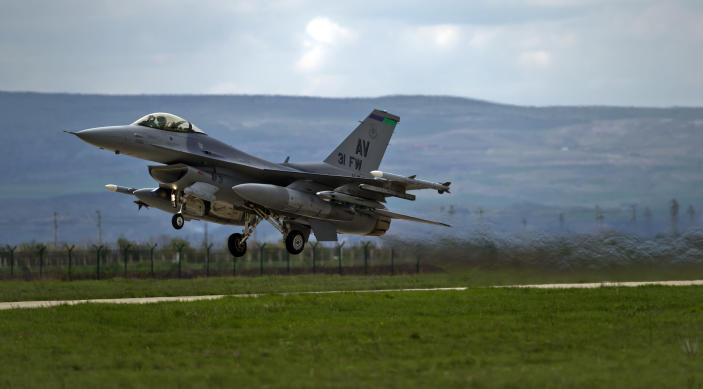 FILE - In this Thursday, April 10, 2014 file picture, an US F16 fighter jet takes off from a Romanian air base in Campia Turzii, Romania. The U.S. Air Force has deployed on Monday, Jan. 4, 2021, about 90 airmen and an unspecified number of drone aircraft to a base in central Romania, boosting its military presence in the region where there are allied concerns that Russia is trying to display its military strength. (AP Photo/Vadim Ghirda, File)