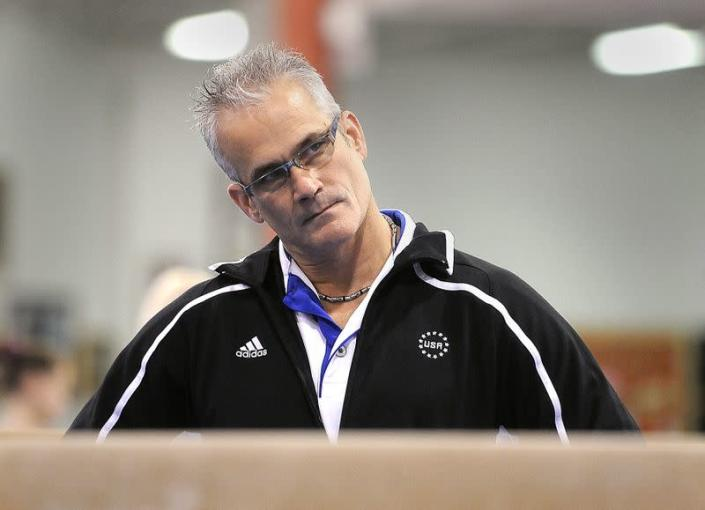 Gymnastics coach John Geddert watches his students during a practice in Lansing