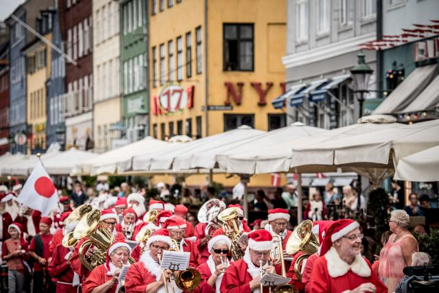 <p>People dressed as Santa Claus and elves take part in a street parade that is part of the annual World Santa Claus congress on July 23, 2018 in Copenhagen. (Photo: Mads Claus Rasmussen/Ritzau Scanpix/AFP/Getty Images) </p>