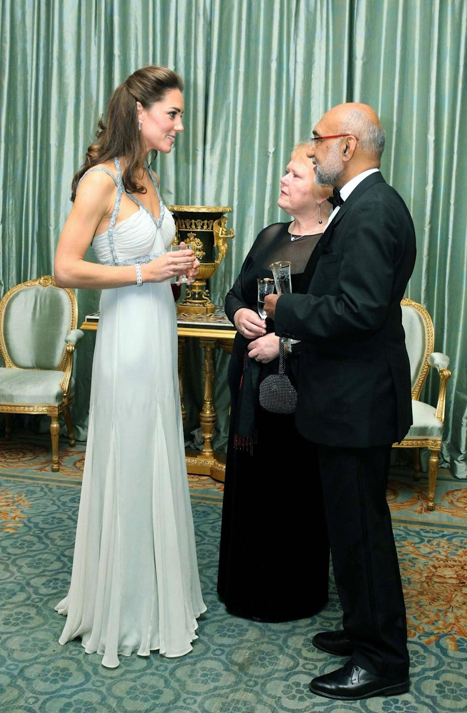 <p>The Duchess attended a charity dinner in a Grecian gown by Amanda Wakeley. She teamed the look with glittering Jimmy Choo sandals. </p><p><i>[Photo: PA]</i></p>