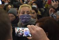 Yulia Navalnaya, wife of Russian opposition leader Alexei Navalny, walks past journalists at Sheremetyevo airport in Moscow