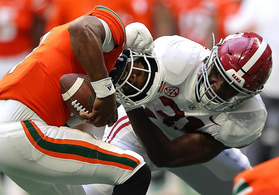 ATLANTA, GEORGIA – SEPTEMBER 04: D'Eriq King #1 of the Miami Hurricanes is escapes a sack attempt by Will Anderson Jr. #31 of the Alabama Crimson Tide during the second half of the Chick-fil-A Kick-Off Game at Mercedes-Benz Stadium on September 04, 2021 in Atlanta, Georgia. (Photo by Kevin C. Cox/Getty Images)