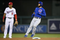 Chicago Cubs' David Bote, right, runs to second base with a double next to Washington Nationals shortstop Adrian Sanchez (9) during the fourth inning of a baseball game, Saturday, July 31, 2021, in Washington. (AP Photo/Nick Wass)