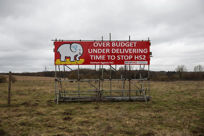 DENHAM, ENGLAND - FEBRUARY 21: A billboard which says 'Time to Stop HS2' stands in a field near to the proposed HS2 route on February 21, 2017 in Denham, England. The HS2 Hybrid Bill, which allows building to begin on the High Speed 2 Rail Network, passes into law on Thursday. The network will provide a high speed rail link from London to the West Midlands, known as Phase 1, with Phase 2 expected to connect Birmingham with Leeds and Manchester. (Photo by Jack Taylor/Getty Images)