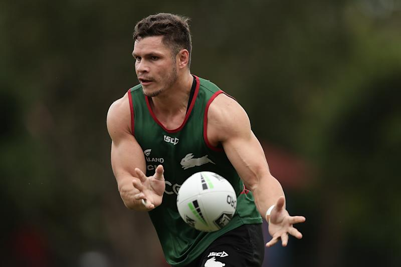 James Roberts runs and passes the ball during a South Sydney Rabbitohs NRL training session.