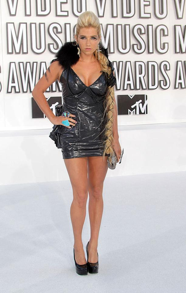 """Best New Artist nominee Ke$ha showed off her stems in a micro mini, which she made out of a trash bag! The """"Blah Blah Blah"""" party girl paired her creative frock with turquoise rings, patent leather platform heels, a silver clutch, and an enormous braid. Frederick M. Brown/<a href=""""http://www.gettyimages.com/"""" target=""""new"""">GettyImages.com</a>"""