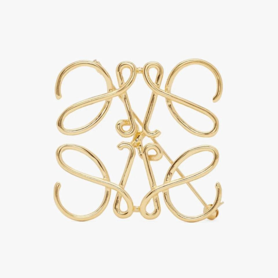 "An elegant brooch that they can wear for years and years to come is always a great idea. $235, MATCHESFASHION.COM. <a href=""https://www.matchesfashion.com/us/products/Loewe-Anagram-brooch-1317696"" rel=""nofollow noopener"" target=""_blank"" data-ylk=""slk:Get it now!"" class=""link rapid-noclick-resp"">Get it now!</a>"