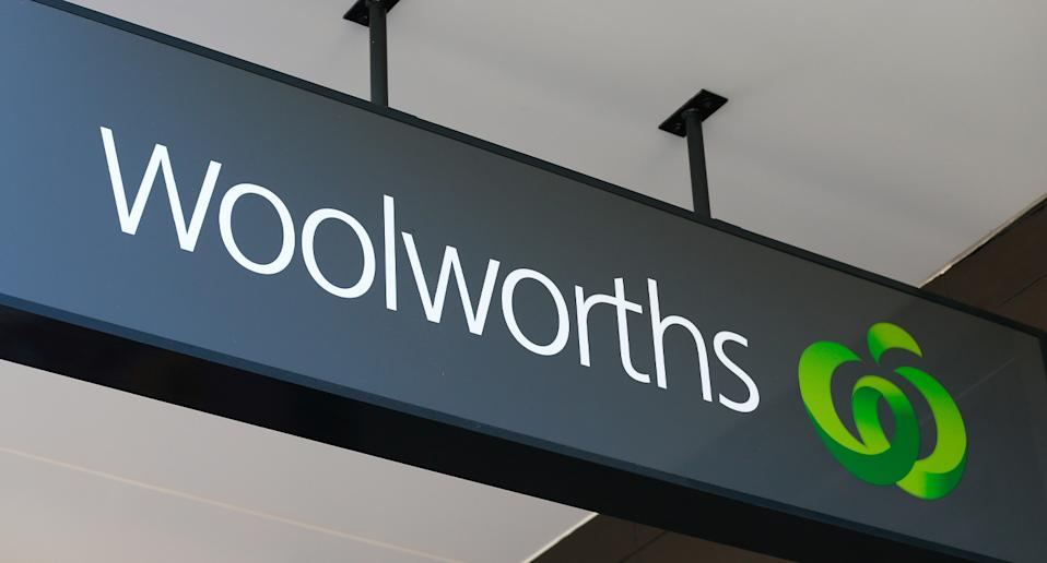 A Woolworth supermarket sign can be seen in the picture.