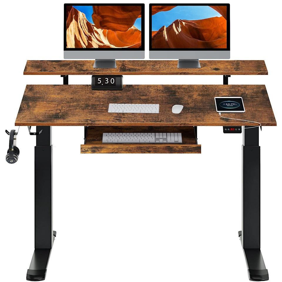 """<h2>Best Standing Desk Under $350<br></h2><br><h3>Rolanstar Standing Desk Dual Motor with USB Charging Ports</h3><br><strong>The Hype</strong>: 4.7 out of 5 stars and 24 ratings on <a href=""""https://amzn.to/3dZqkHv"""" rel=""""nofollow noopener"""" target=""""_blank"""" data-ylk=""""slk:Amazon"""" class=""""link rapid-noclick-resp"""">Amazon</a><br><br><strong>WFH Heroes Say</strong>: """"Love this desk. Great for sitting and really great for standing. Lots of space and great design. Only minor negative--I wish the keyboard tray were a couple of inches wider for easier mouse-work. (So I just bought an extension for the arm of my chair for mouse-work.) I paid for professional assembly- well worth the $65 charge.""""<br><br><em>Shop</em> <strong><em><a href=""""https://amzn.to/3jXSvtV"""" rel=""""nofollow noopener"""" target=""""_blank"""" data-ylk=""""slk:Rolanstar"""" class=""""link rapid-noclick-resp"""">Rolanstar</a></em></strong><br><br><strong>Rolanstar</strong> Standing Desk Dual Motor with USB Charging Ports, $, available at <a href=""""https://amzn.to/3dXULO3"""" rel=""""nofollow noopener"""" target=""""_blank"""" data-ylk=""""slk:Amazon"""" class=""""link rapid-noclick-resp"""">Amazon</a>"""