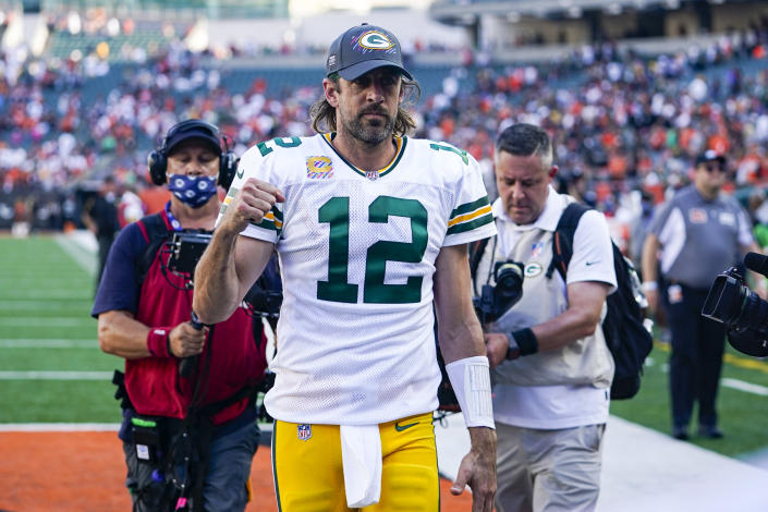 Green Bay Packers quarterback Aaron Rodgers (12) pumps his fist as he leaves the field following an NFL football game against the Cincinnati Bengals in Cincinnati, Sunday, Oct. 10, 2021. (AP Photo/Bryan Woolston)