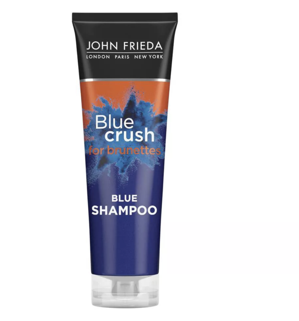 """<p><strong>John Frieda</strong></p><p>target.com</p><p><strong>$9.99</strong></p><p><a href=""""https://www.target.com/p/john-frieda-blue-crush-shampoo-8-45-fl-oz/-/A-80109119"""" rel=""""nofollow noopener"""" target=""""_blank"""" data-ylk=""""slk:Shop Now"""" class=""""link rapid-noclick-resp"""">Shop Now</a></p><p>We trust John Frieda with all things hair color. This genius blue shampoo deposits a brass-fighting tint in hair without staining your hands (or shower). </p>"""