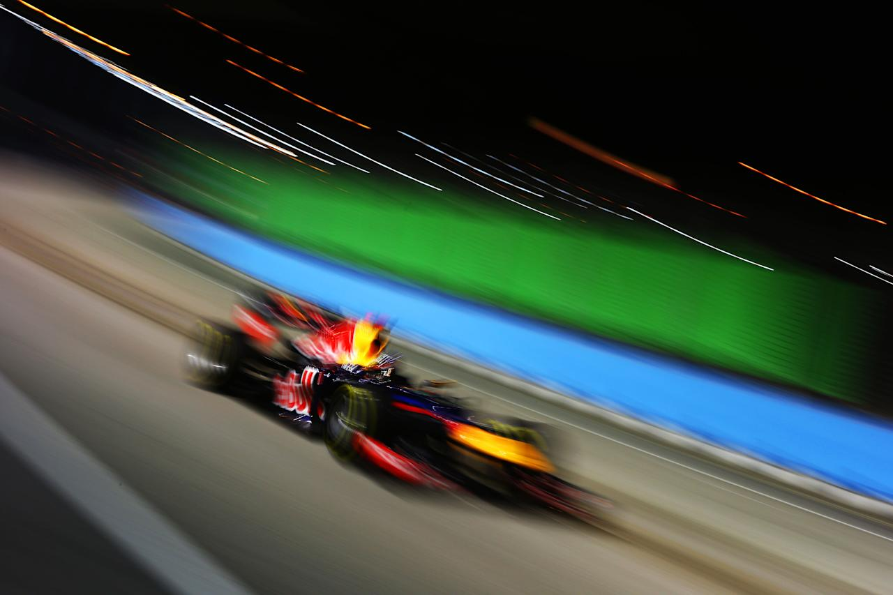SINGAPORE - SEPTEMBER 23:  Sebastian Vettel of Germany and Red Bull Racing drives on his way to winning the Singapore Formula One Grand Prix at the Marina Bay Street Circuit on September 23, 2012 in Singapore, Singapore.  (Photo by Paul Gilham/Getty Images)