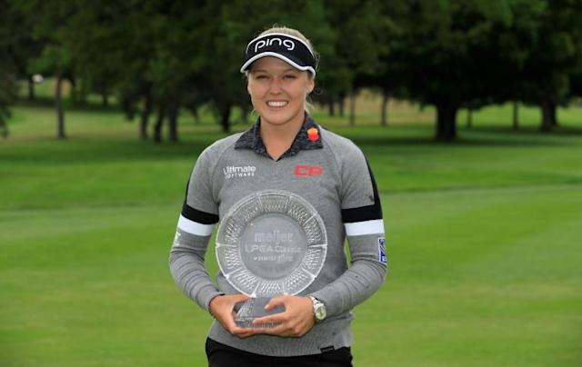 Canada's Brooke Henderson, holding last year's Meijer LPGA Classic winner's trophy, will not get to defend her crown this year as the tour cancelled the 2020 edition of the tournament on Wednesday (AFP Photo/ANDY LYONS)
