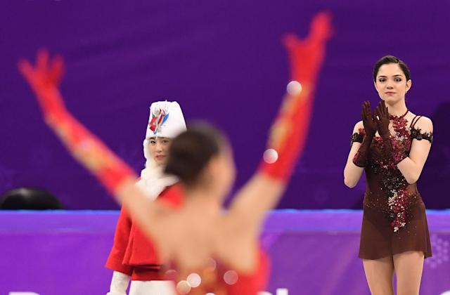 <p>Gold medallist Russia's Alina Zagitova celebrates (L) as silver medallist Russia's Evgenia Medvedeva claps before the venue ceremony after the women's single skating free skating of the figure skating event during the Pyeongchang 2018 Winter Olympic Games at the Gangneung Ice Arena in Gangneung on February 23, 2018. / AFP PHOTO / Roberto SCHMIDT </p>