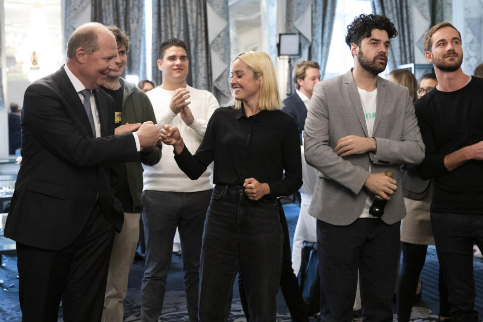 """Laura Zimmermann, Co-President of Operation Libero, centre, together with Valentin Vogt, President of the Swiss Employers' Federation, Renato Perlini, campaign manager of Operation Libero, and Stefan Manser-Egli, Co-President of Operation Libero, from left, are pleased with the result of the vote at the meeting of opponents of the popular initiative """"For moderate immigration"""" (restrictive initiative), on Sunday, Sept. 27, 2020 at the Hotel Schweizerhof in Bern, Switzerland. (Peter Klaunzer/Keystone via AP)"""