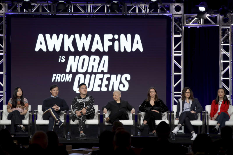 """Awkwafina, from left, BD Wong, Bowen Yang, Lori Tan Chinn, Lucia Aniello, Karey Dornetto and Teresa Hsiao speak at the """"Akwafina is Nora from Queens"""" panel during the Comedy Central TCA 2020 Winter Press Tour at the Langham Huntington on Tuesday, Jan. 14, 2020, in Pasadena, Calif. (Photo by Willy Sanjuan/Invision/AP)"""
