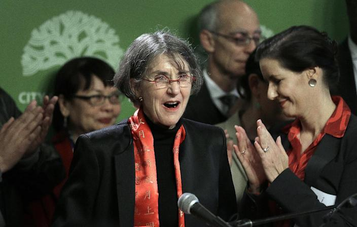 In this Jan. 4, 2017 file photo, Oakland, Calif., Mayor Libby Schaaf, right, applauds as newly named Oakland Chief of Police Anne Kirkpatrick, center, is introduced during a media conference in Oakland. When Kirkpatrick took the helm at the scandal-ridden Oakland Police Department, she inherited an agency that the city's mayor likened to a frat house. Kirkpatrick is among the growing number of women heading departments, many in need of image makeovers. (AP Photo/Ben Margot, File)