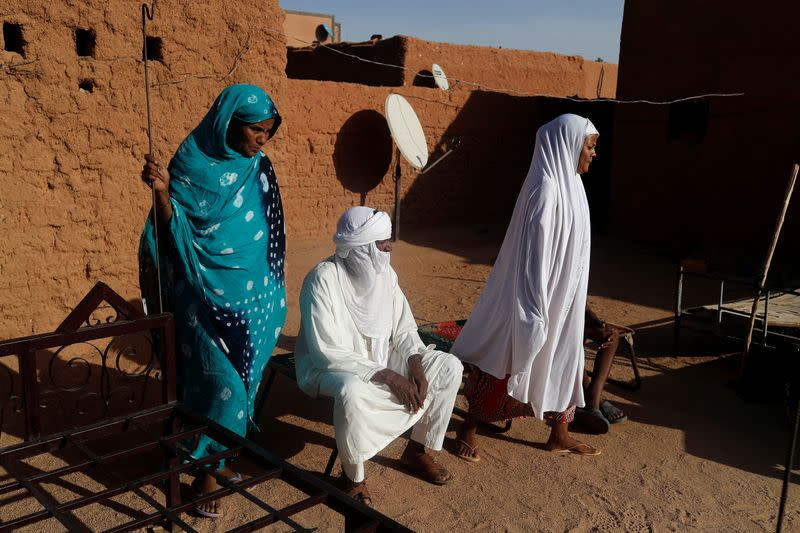 Silymane Hiyan Hiyar, 53, an ex-rebel and leading member of the peace committee, sits at his home's courtyard in Agadez