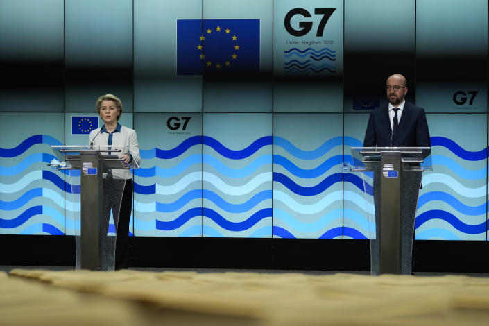 European Commission President Ursula von der Leyen, left, speaks during a joint news conference with European Council President Charles Michel ahead of the G7 summit, at the EU headquarters in Brussels, Thursday, June 10, 2021. Charles Michel and Ursula von der Leyen will attend the G7 summit in Cornwall, southwest England. (AP Photo/Francisco Seco, Pool)