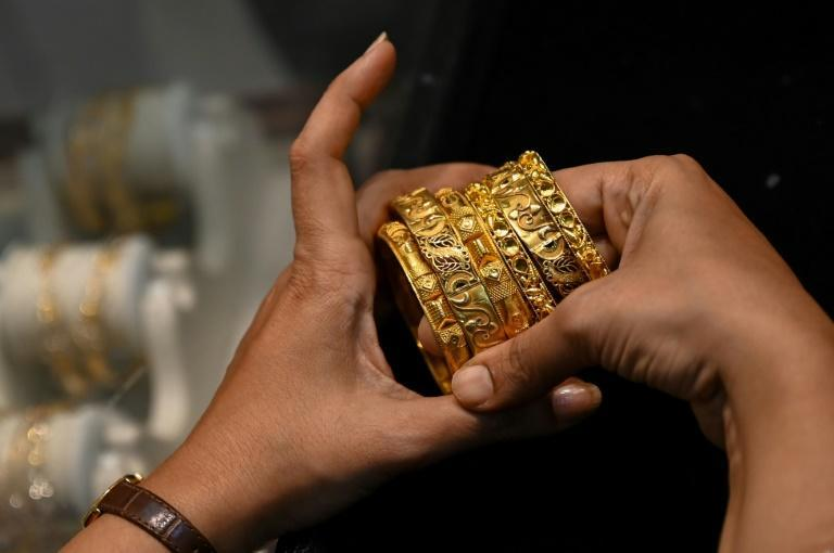 While the economy is recovering, many indians are still struggling financially, forcing them to sell their most cherished asset -- gold (AFP/Punit PARANJPE)