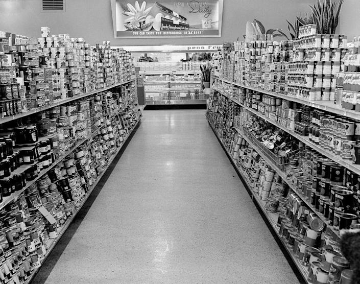 """<p>Grocery stores remodeled their aisles, <a href=""""https://www.mentalfloss.com/article/26470/brief-history%E2%80%94and-future%E2%80%94-shopping-cart"""" rel=""""nofollow noopener"""" target=""""_blank"""" data-ylk=""""slk:making them wider"""" class=""""link rapid-noclick-resp"""">making them wider</a>, so that multiple carts could fit at one time. </p>"""