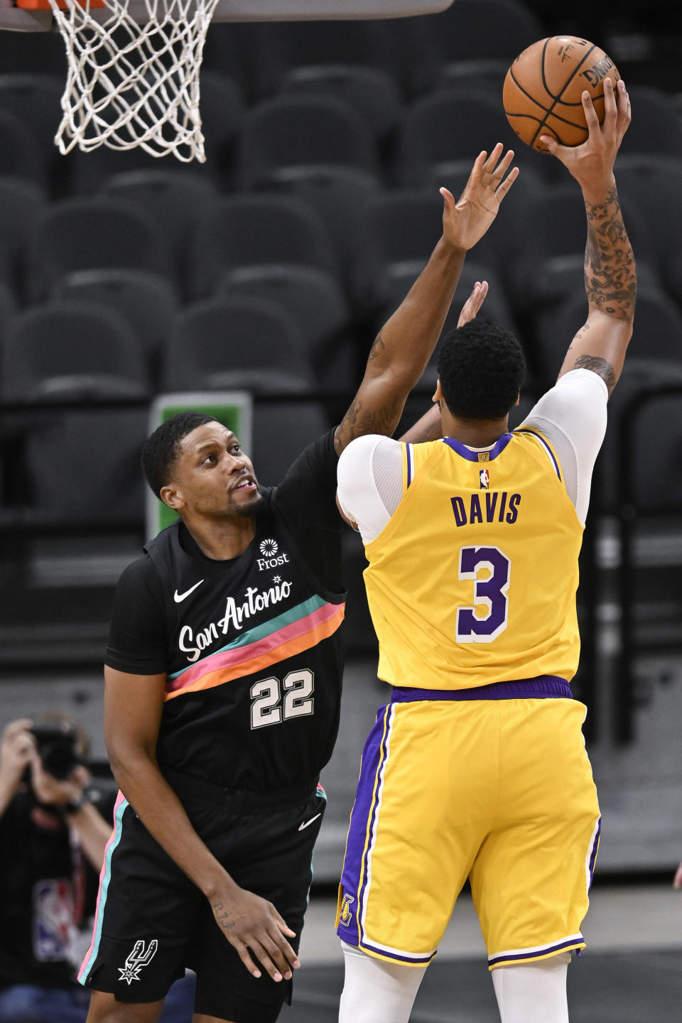 Los Angeles Lakers' Anthony Davis (3) shoots over San Antonio Spurs' Rudy Gay during the first half of an NBA basketball game Friday, Jan. 1, 2021, in San Antonio. (AP Photo/Darren Abate)