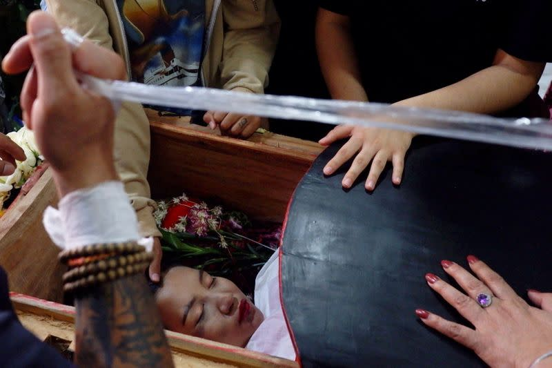 The body of 19-year-old protester Angel lies during her funeral in Mandalay