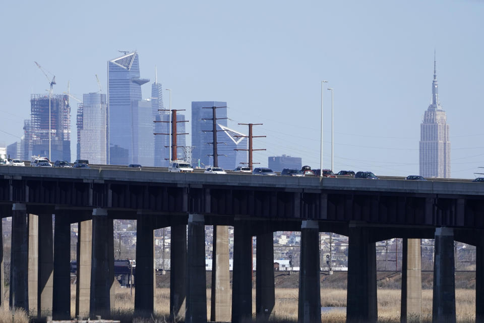 "Cars travel on a raised expressway, in front of buildings in both New Jersey and New York, in Kearny, N.J., Tuesday, April 6, 2021. President Joe Biden is setting about convincing America it needs his $2.3 trillion infrastructure plan, deputizing a five-member ""jobs Cabinet"" to help in the effort. But the enormity of his task is clear after Senate Minority Leader Mitch McConnell's vowed to oppose the plan ""every step of the way."" (AP Photo/Seth Wenig)"