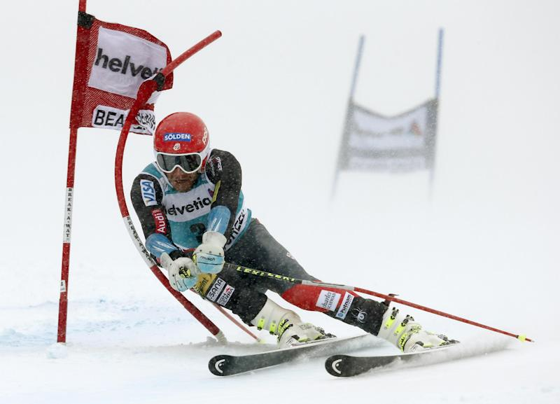 Bode Miller clips a gate on his first run during the men's World Cup giant slalom skiing event, Sunday, Dec. 8, 2013, in Beaver Creek, Colo.(AP Photo/ Charles Krupa)