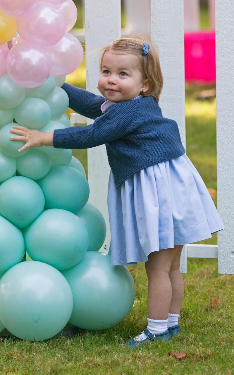 Princess Charlotte, walking and talking at a children's party in Canada last year