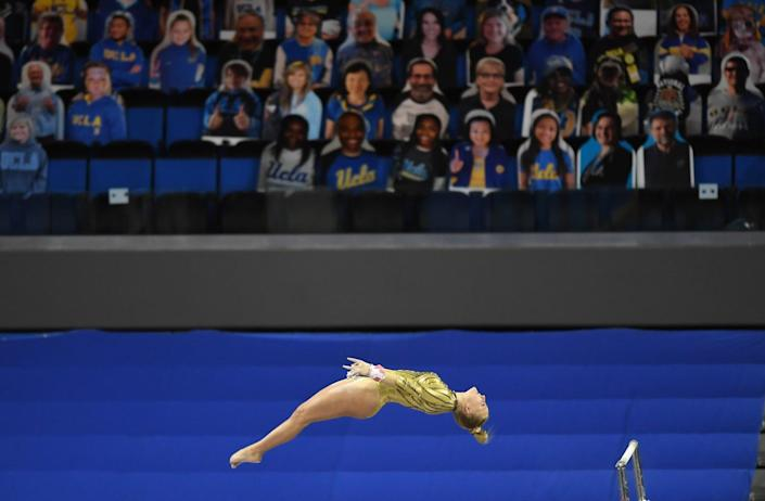UCLA's Savannah Kooyman dismounts from the uneven bars during competition against BYU at Pauley Pavillion Wednesday.