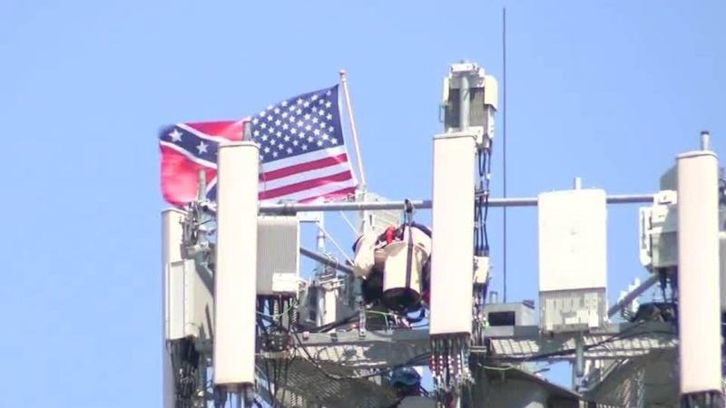 An Iconic Communications worker hung up a half-American and half-Confederate flag from a cellphone tower in Omaha, Neb. (Credit:KMTV)