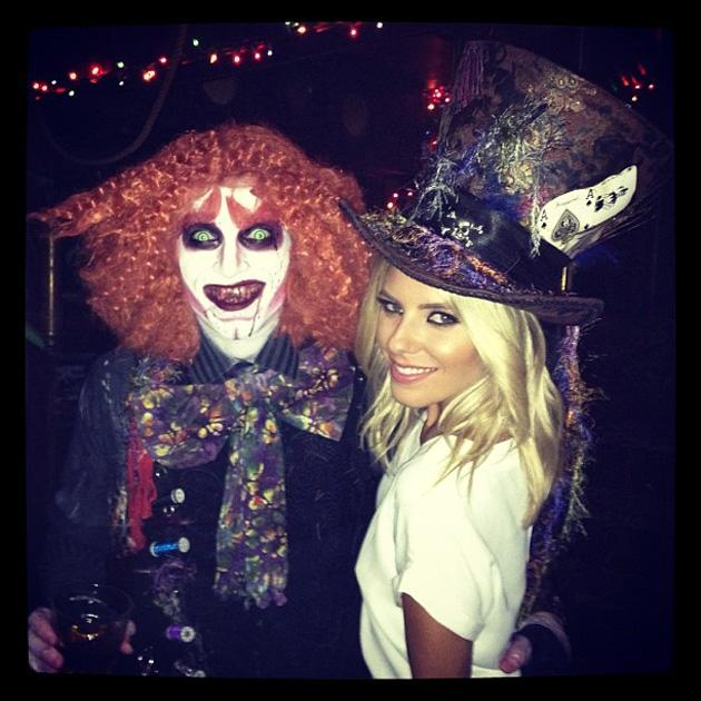 The Saturdays' Mollie King dons her best Alice in Wonderland hat for an LA Halloween.