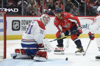 Montreal Canadiens goaltender Carey Price (31) watches the puck as Washington Capitals left wing Alex Ovechkin (8), of Russia, closes in during the first period of an NHL hockey game, Friday, Nov. 15, 2019, in Washington. (AP Photo/Nick Wass)