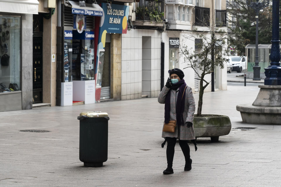 A young woman protected by a mask in a central street of the city by the mandatory one decreed by the government as a consequence of the coronavirus (Covid-19) in Santander (Photo by Joaquin Gomez Sastre/NurPhoto via Getty Images)