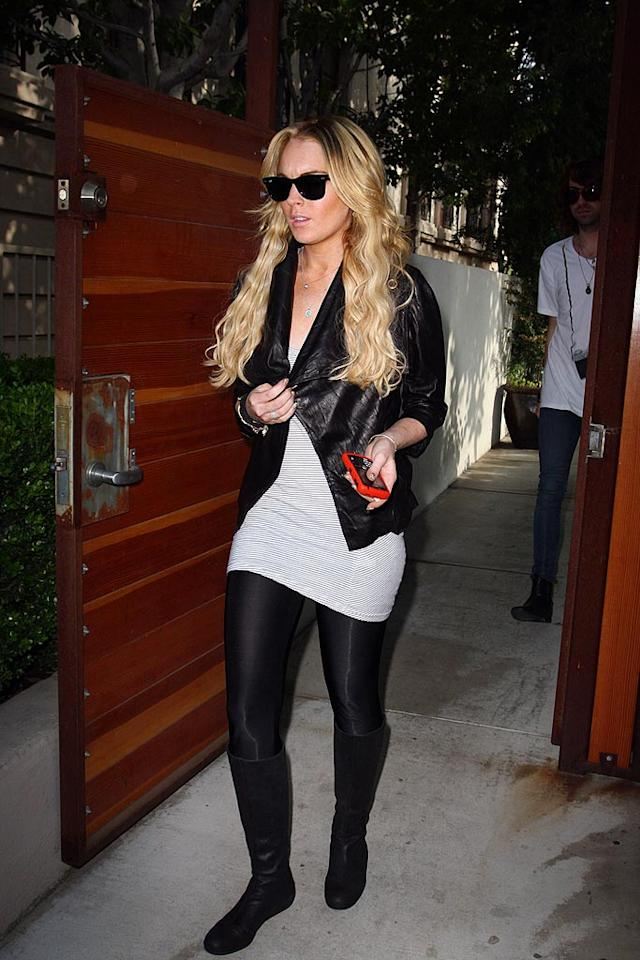 """Lindsay pops by the Chris McMillan Salon in Beverly Hills to tame her wild mane. The posh shop also attends to Lohan's A-list peers: Victoria Beckham, Paris Hilton, and Nicole Richie. PhamousFotos/<a href=""""http://www.splashnewsonline.com"""" target=""""new"""">Splash News</a> - April 4, 2008"""