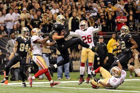 Nov 9, 2014; New Orleans, LA, USA; New Orleans Saints tight end Jimmy Graham (80) catches an apparent touchdown catch, but was flagged for offensive pass interference on the last play of regulation against the San Francisco 49ers at Mercedes-Benz Superdome. The 49ers won 27-24. Mandatory Credit: Chuck Cook-USA TODAY Sports