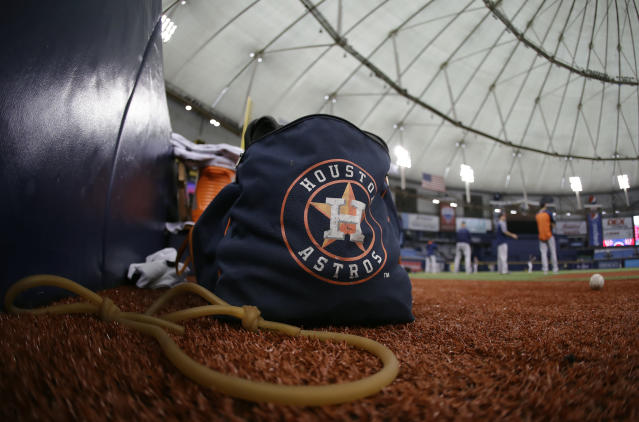 Astros players warm up before Tuesday's game against the Rangers in St. Petersburg, Fla. The three-game series was moved to St. Petersburg because of unsafe conditions from Hurricane Harvey. (AP)