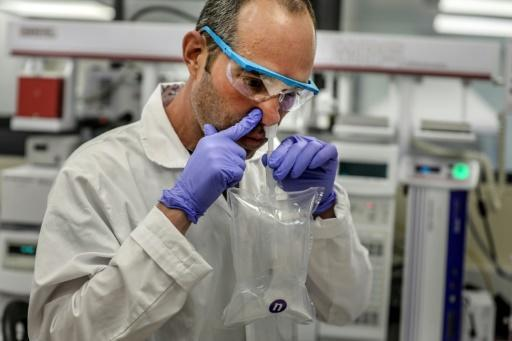 A researcher demonstrates a coronavirus breathalyser test at NanoScent's lab in Israel