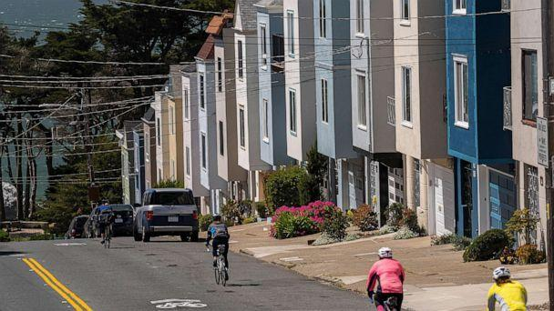 PHOTO: Cyclists ride past residential housing in San Francisco, April 9, 2021.  (Bloomberg via Getty Images, FILE)
