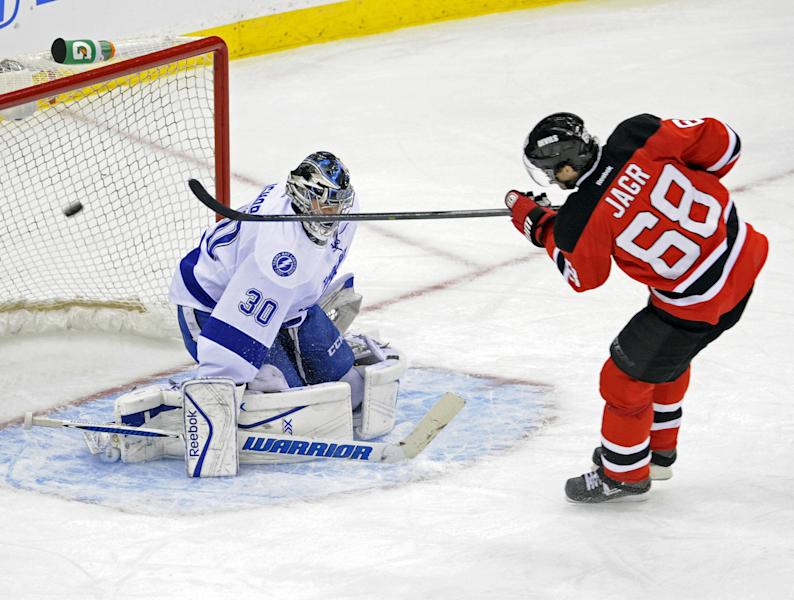 New Jersey Devils' Jaromir Jagr (68), of the Czech Republic, scores an unassisted goal against Tampa Bay Lightning goaltender Ben Bishop during the second period of an NHL hockey game Tuesday, Oct. 29, 2013, in Newark, N.J. (AP Photo/Bill Kostroun)
