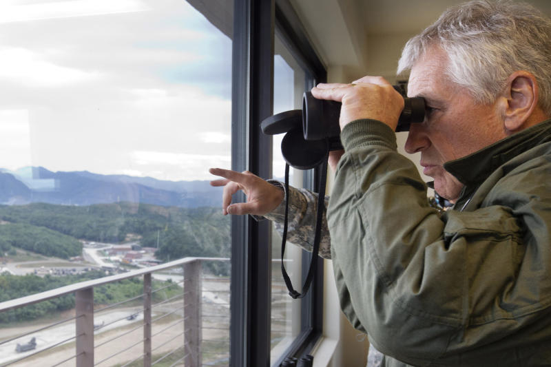 U.S. Secretary of Defense Chuck Hagel looks through binoculars to observe training at the Rodriguez Live Fire Complex (RLFC), just miles south of the Demilitarized Zone (DMZ), the military border separating the two Koreas, South Korea, on Monday, Sept. 30, 2013. Hagel is in South Korea for celebrations marking the 60th anniversary of the ending of the Korean War before heading to Japan for ministerial meetings. (AP Photo/Jacquelyn Martin, Pool)