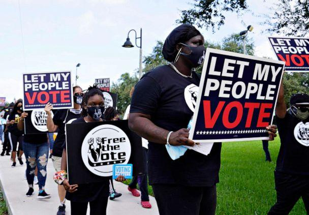 PHOTO: Supporters of restoring Florida felons' voting rights march to an early voting precinct, Oct. 24, 2020, in Fort Lauderdale, Fla. (Marta Lavandier/AP)